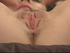 MILF stuffs pussy with large white dildo