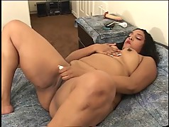 Big black chick rubs her nice tits and slides vibrator inside her pussy