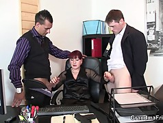 Business woman spreads her legs for two cocks