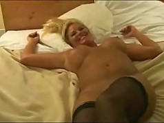 gorgeous MILF playing with 2 BBC