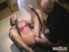 Brutally fisting his wifes greedy pussy while she works out