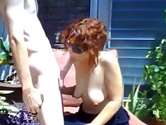 MILF Sucks Boytoy Outside
