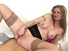 Sexy mother feeding her pussy on table